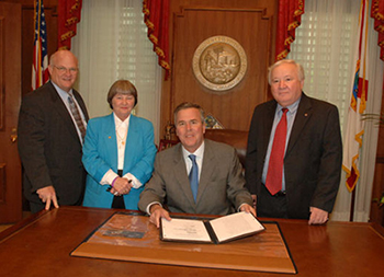 NRA lobbyist Marion Hammer with Governor Bush at Stand Your Ground bill signing, April 2005