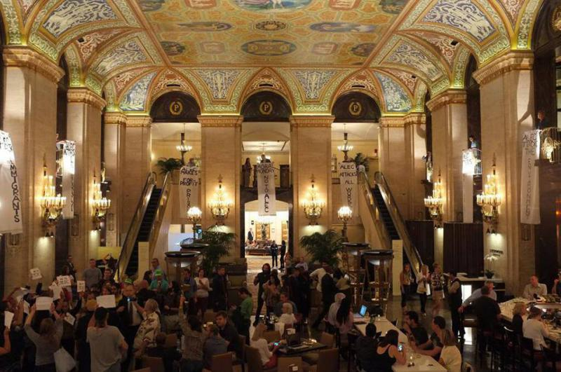 Protestors drop three banners inside the Palmer House Hilton (Source: US Uncut)